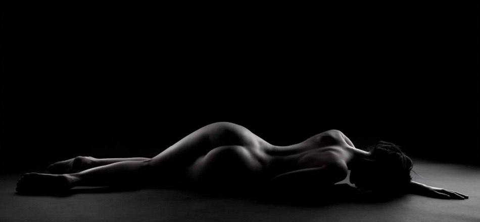Black and White Nude Lying on Stomach Woman