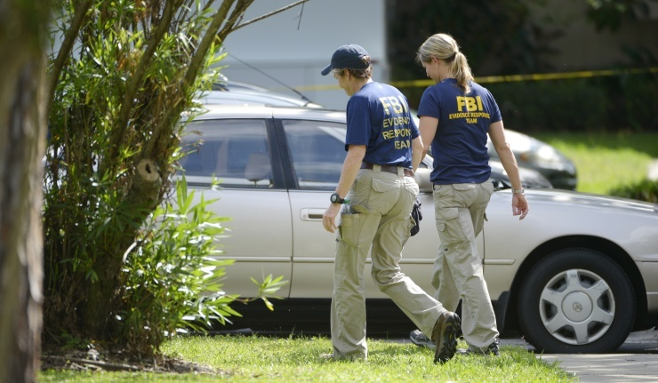 FBI personnel walk through the complex surrounding the apartment, where Ibragim Todashev, 27, was shot and killed by FBI